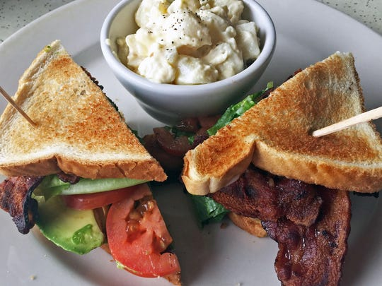 Bacon, lettuce, tomato and avocado sandwich with potato salad