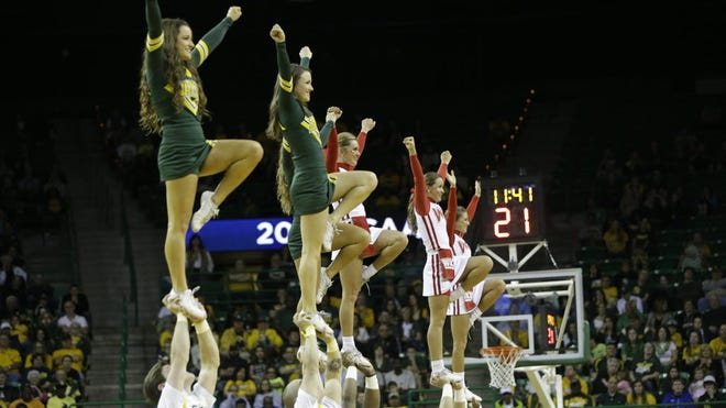Members of the Baylor and Western Kentucky cheerleading team perform during a first-round game in the NCAA women's college basketball tournament, on March 22 in Waco.