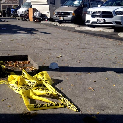 Police tape remains near the parking lot where a 20-year-old