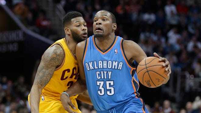 Oklahoma City's Kevin Durant, right, is fouled by Cleveland's Alonzo Gee during the third quarter Thursday in Cleveland. Oklahoma City defeated Cleveland 102-95.