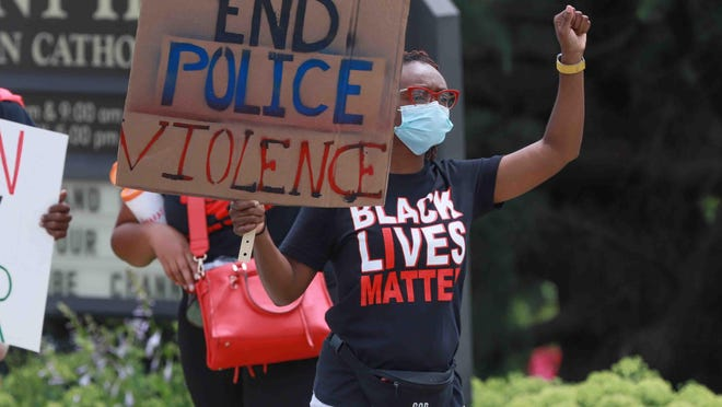Protesters call for police reform Saturday, June 27, 2020, at St. Helena's Parish, across from Delaware State Police Troop 1 in Penny Hill.