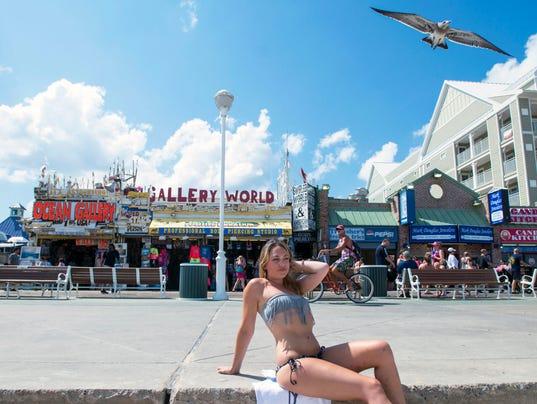 'Pole Doll' goes public, clothed on beach boardwalk