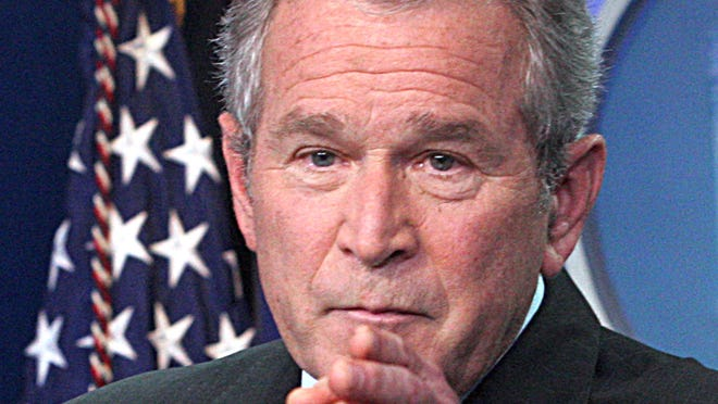 Former president George W. Bush speaks during a press conference at the White House in Washington, DC, in this September 20, 2007 photo.