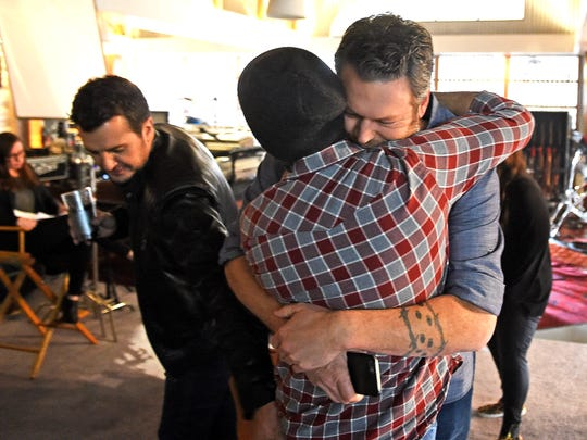 Blake Shelton hugs Executive Producer Lee Metzger at