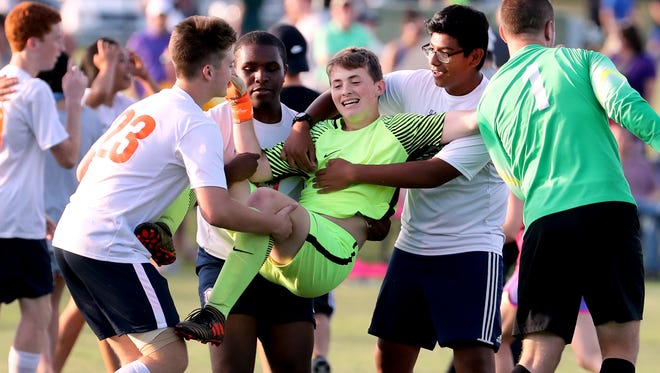 Blackman sophomore reserve goalkeeper Andrew Hawkins gets hoisted by teammates after stopping three of five penalty kicks to help the Blaze defeat Brentwood in the Class AAA state soccer semifinals Wednesday.
