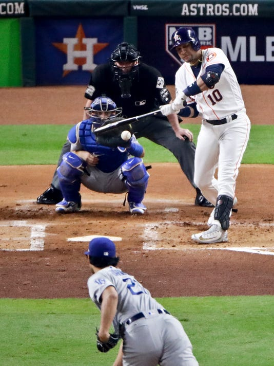 Houston Astros' Yuli Gurriel hits a home run off Los Angeles Dodgers starting pitcher Yu Darvish, of Japan, during the second inning of Game 3 of baseball's World Series Friday, Oct. 27, 2017, in Houston. (AP Photo/Charlie Riedel)