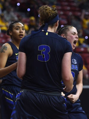 Nevada players celebrate after scoring against Wyoming during the Mountain West Women's Basketball Championships at the Thomas & Mack Center in Las Vegas on March 7, 2018.