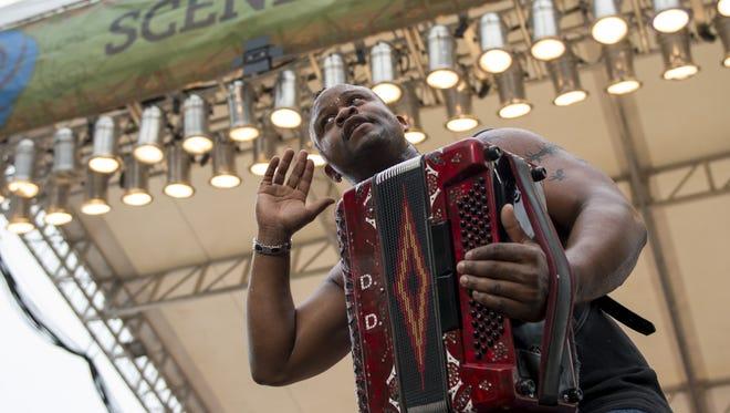 Lafayette native Dwayne Dopsie performs for the crowd at the 2015 Festival International de Louisiane.