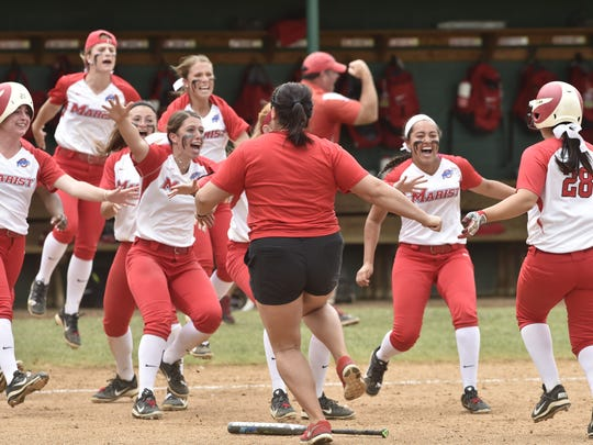 The Marist softball team rushes the field after Brittany Colombo's walkoff hit in MAAC final. May 14, 2016.