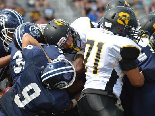 Solanco quarterback Joel McGuire tries to push through