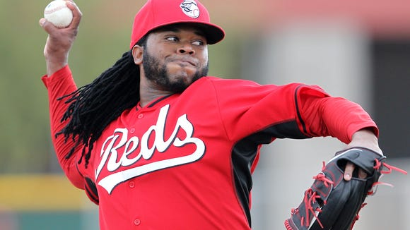 Reds starting pitcher Johnny Cueto throws during a live batting-practice session at spring training on March 1.