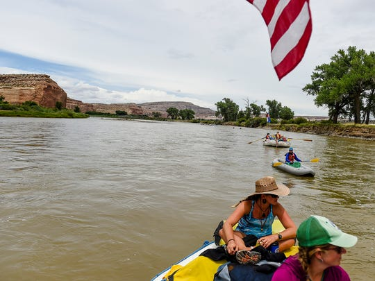 A group with Adventure Bound River Expeditions rafts down the Colorado River, exploring Ruby and Horsethief Canyons.