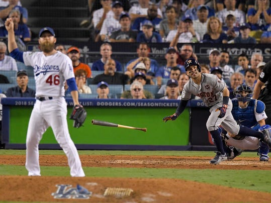 Houston Astros' Jose Altuve celebrates after a home run off Los Angeles Dodgers relief pitcher Josh Fields during the 10th inning of Game 2 of baseball's World Series Wednesday, Oct. 25, 2017, in Los Angeles. (AP Photo/Mark J. Terrill)