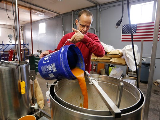 Owner/brewer Tom Bulington brews pumpkin spice ale Tuesday, October 31, 2017, at Crasian Brewing Company, 207 S. Railroad Street in Brookston. Crasian Brewing Company is open Thursday through Sunday.
