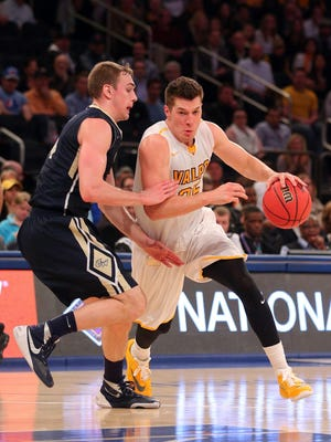 Valparaiso Crusaders forward Alec Peters (25) drives against George Washington Colonials forward Tyler Cavanaugh (34) during the first half of the championship game of the 2016 NIT basketball tournament at Madison Square Garden.