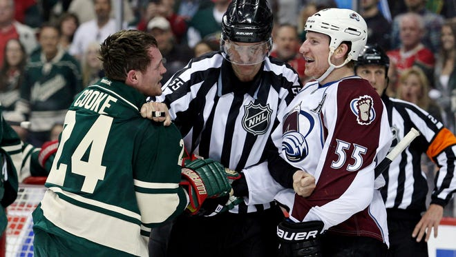 Colorado Avalanche forward Cody McLeod (55) talks with Minnesota Wild forward Matt Cooke (24) during the first period of Game 3.