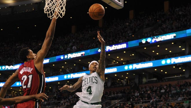 Isaiah Thomas (4) was one of six Celtics to score in double figures.