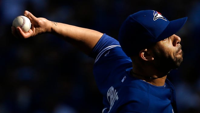Blue Jays pitcher David Price throws against the Royals during the second inning in Game 2 of the American League Championship Series on Saturday in Kansas City, Mo.