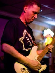 Musician Mike Woolf performs with his band, Twenty
