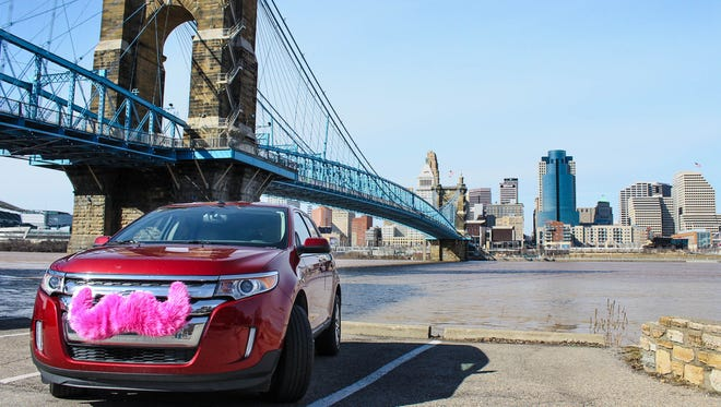 Lyft's vehicles can be identified by a pink mustache attached to the grill.