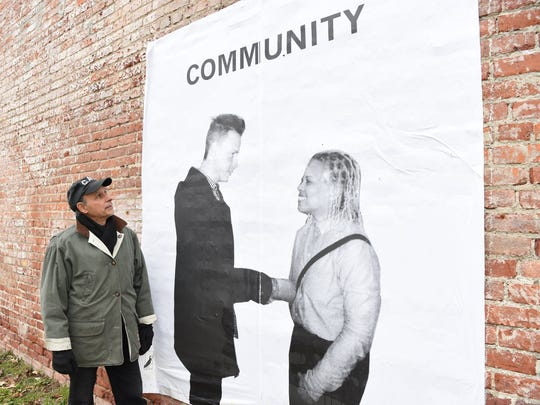 """Franc Palaia, an artist and muralist from Rhinebeck, looks over one of his installments in a series of a murals called """"Community Portraits."""""""
