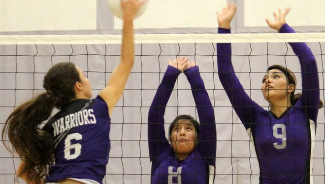 Mescalero's Penny Largo (8) and Lauryn Yuzos (9) jump to block a shot from Gateway Christian's Savannah Fox on Thursday night.