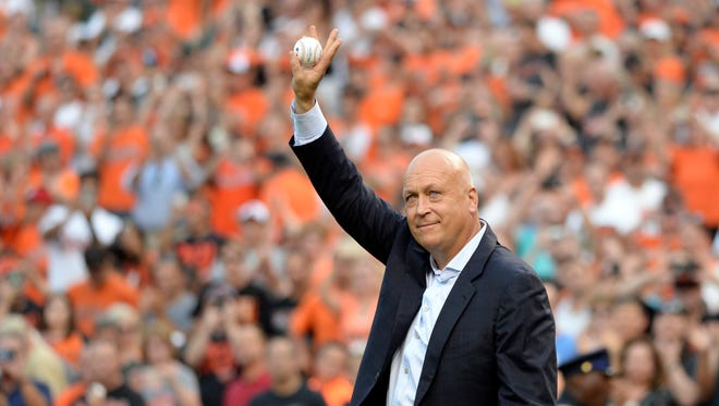 Cal Ripken Jr.  throws out the first pitch on the 20th anniversary of breaking Lou Gehrig's 2131 consecutive games played streak.