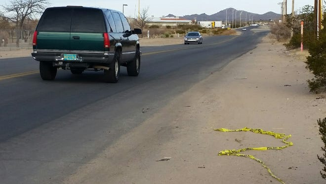 Remnants of police tape are seen the morning of Wednesday, Dec. 27, 2017, along Del Rey Boulevard near where a pedestrian was struck by a bus the previous evening. The pedestrian later died from her injuries.