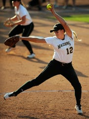 Comanche pitcher Madison Hagood (12) throws a pitch during the bottom of the second inning of Comanche's 1-0 loss to East Bernard in the Class 3A state semifinal on Wednesday, June 3, 2015, at McCombs Field in Austin.
