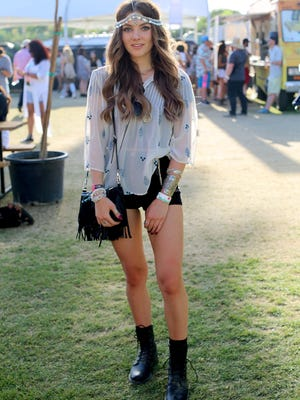Music fan Chloe Rodgers in a ZARA top, LF accesories, and boots by Pride attends the 2015 Coachella Valley Music and Arts Festival - Weekend 1 at The Empire Polo Club on April 12, 2015 in Indio, California.