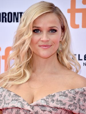 "Actress Reese Witherspoon is writing her first book, a ""lifestyle"" guide."