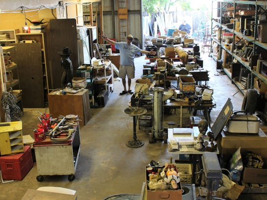 Joe Pete, well-known for preparing estate sales, celebrates the enormity of the junk found in a warehouse at 1057 Chestnut St.