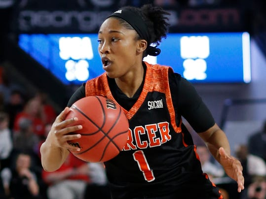 Mercer guard Sydni Means (1) moves the ball down the court during the second half of a first-round game against Georgia in the NCAA women's college basketball tournament in Athens, Ga., Saturday, March. 17, 2018. Georgia won 68-63. (AP Photo/Joshua L. Jones)