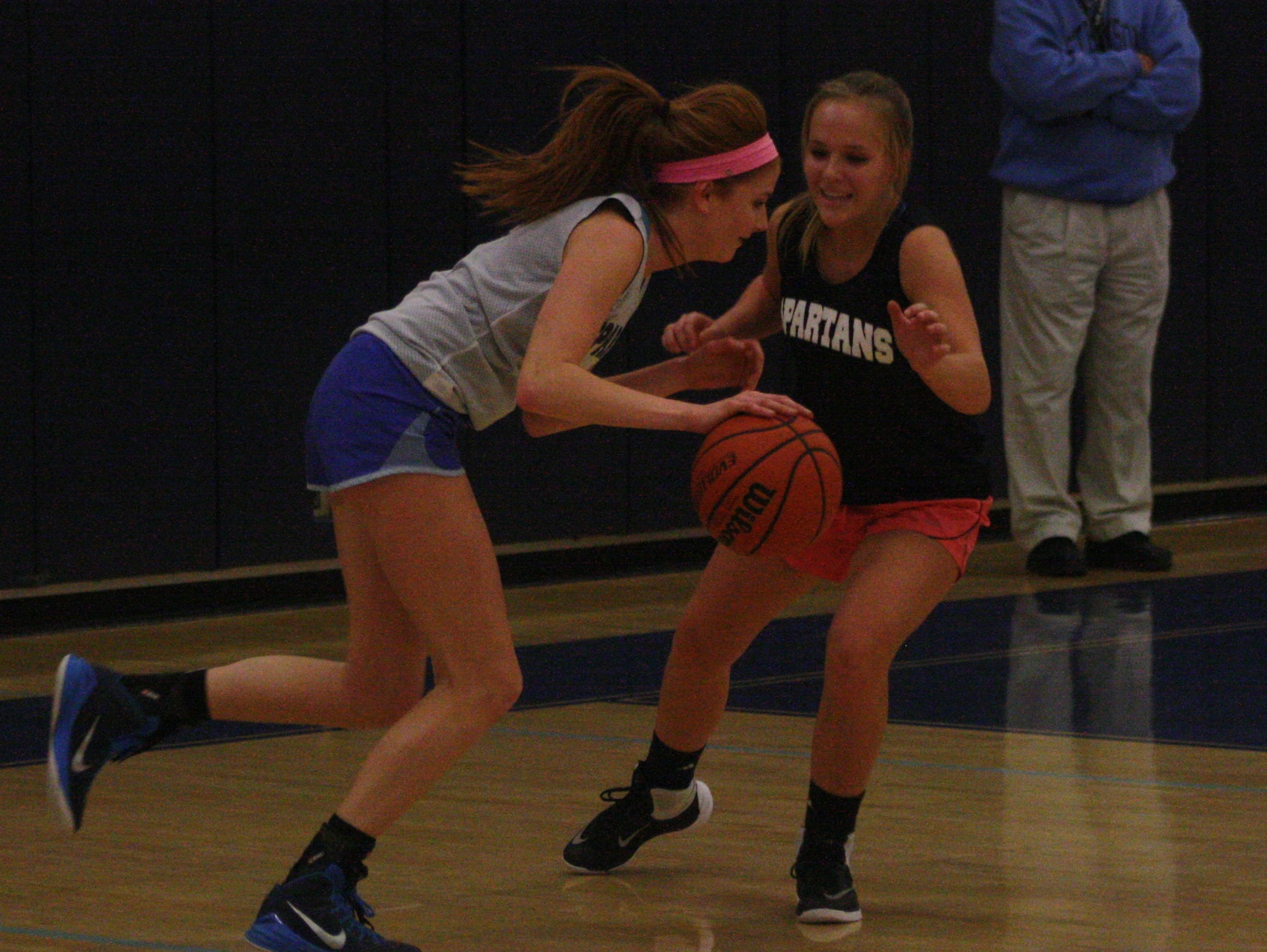 Junior guard Grace Lamerson looks to drive during a Monday practice drill.