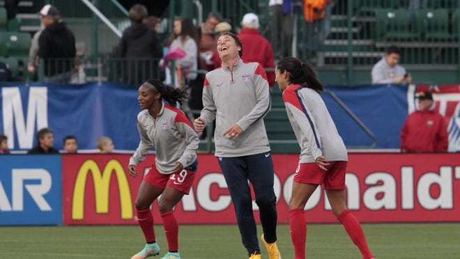 Abby Wambach laughs with teammates prior to the game.