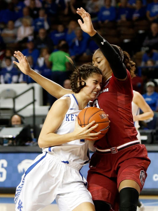 Kentucky's Maci Morris, left, collides with South Carolina's Kaela Davis during the fourth quarter of an NCAA college basketball game, Thursday, Feb. 2, 2017, in Lexington, Ky. (AP Photo/James Crisp)