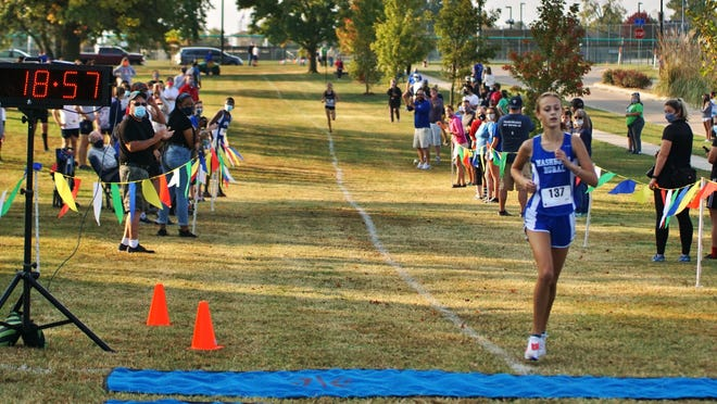 Washburn Rural sophomore Madeline Carter nears the finish line to win the city girls cross country title last Saturday at the Kanza Park course.