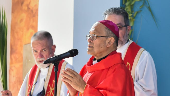 In this file photo, Archbishop Anthony Sablan Apuron delivers his opening prayer during Palm Sunday Mass at the Dulce Nombre de Maria Cathedral-Basilica.