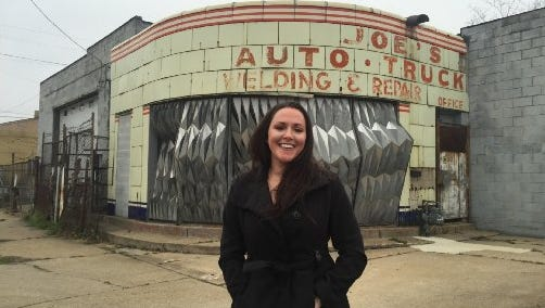 Chef Kate Williams stands in front of the former garage in North Corktown where she plans to open her future restaurant, Lady of the House, this summer.