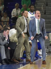 Amanda Inscore/The News-Press:  FGCU coach Joe Dooley yells at his players on defense in FGCU's 86-77 defeat of La Salle on Thursday, Dec. 31, 2015, in Alico Arena.