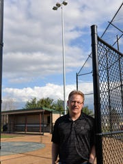 One of the massive lights that illuminates the Fredericksburg Lions Park Ballfield towers above Mike Spangler, president of the Northern Lebanon Little League on April 1, 2016.