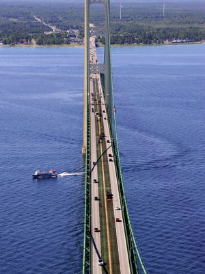 Traffic moves from Michigan's Lower Peninsula to the Upper Peninsula on the Mackinac Bridge last summer. The writer comments on a pipeline that runs below the Straights of Mackinac.
