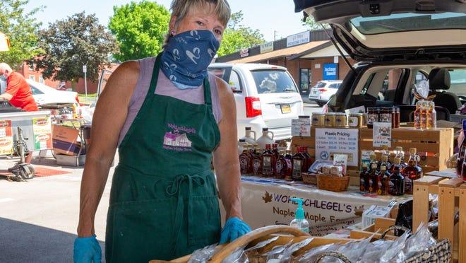 Bobbi Wohlschlegel greets customers on behalf of Wohlschlegel's Naples Maple Farm   at the Canandaigua Farmers Market.