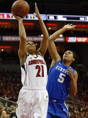 U of L's Bria Smith hits an early bucket Sunday against UK at the KFC Yum! Center.