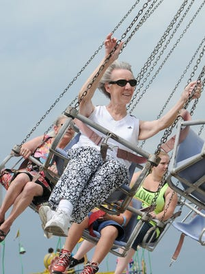 Edie Hahlbeck of Delafield enjoys a ride on the swings at the 2015 Waukesha County Fair