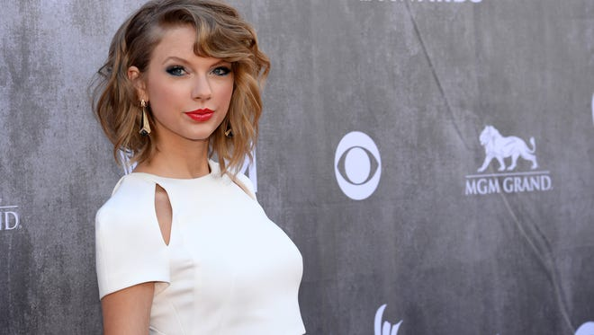 Taylor Swift arrives at the 49th annual Academy of Country Music Awards at the MGM Grand Garden Arena in Las Vegas on April 6, 2014.