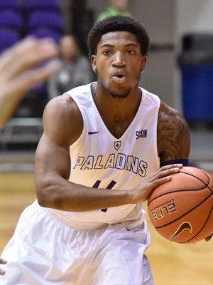 Stephen Croone's tip-in at the buzzer lifted Furman to a 63-62 win over Wofford Saturday.