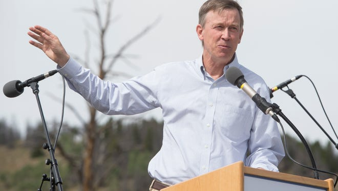 Governor John Hickenlooper speaks during the rededication ceremony  marking Rocky Mountain National Park's 100th anniversary Friday, September 4, 2015.