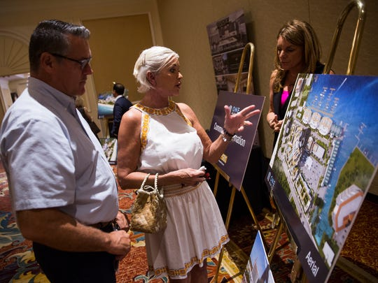 Dan and Kathy Conley discuss the proposed property with Claudine LeŽger-Wetzel, vice president of sales and marketing with Stock Development, during an open house Wednesday, May 17, 2017, at the Ritz Carlton beach resort in North Naples. Vanderbilt Holdings LLC, an affiliate of Stock Development, wants to develop a project called One Naples that would include Stock Development's first high-rise, an 18-story condo building over three levels of parking.