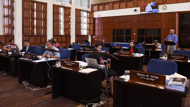 In this June 27 file photo, members of the 34th Guam Legislature meet in session at the Guam Congress Building.